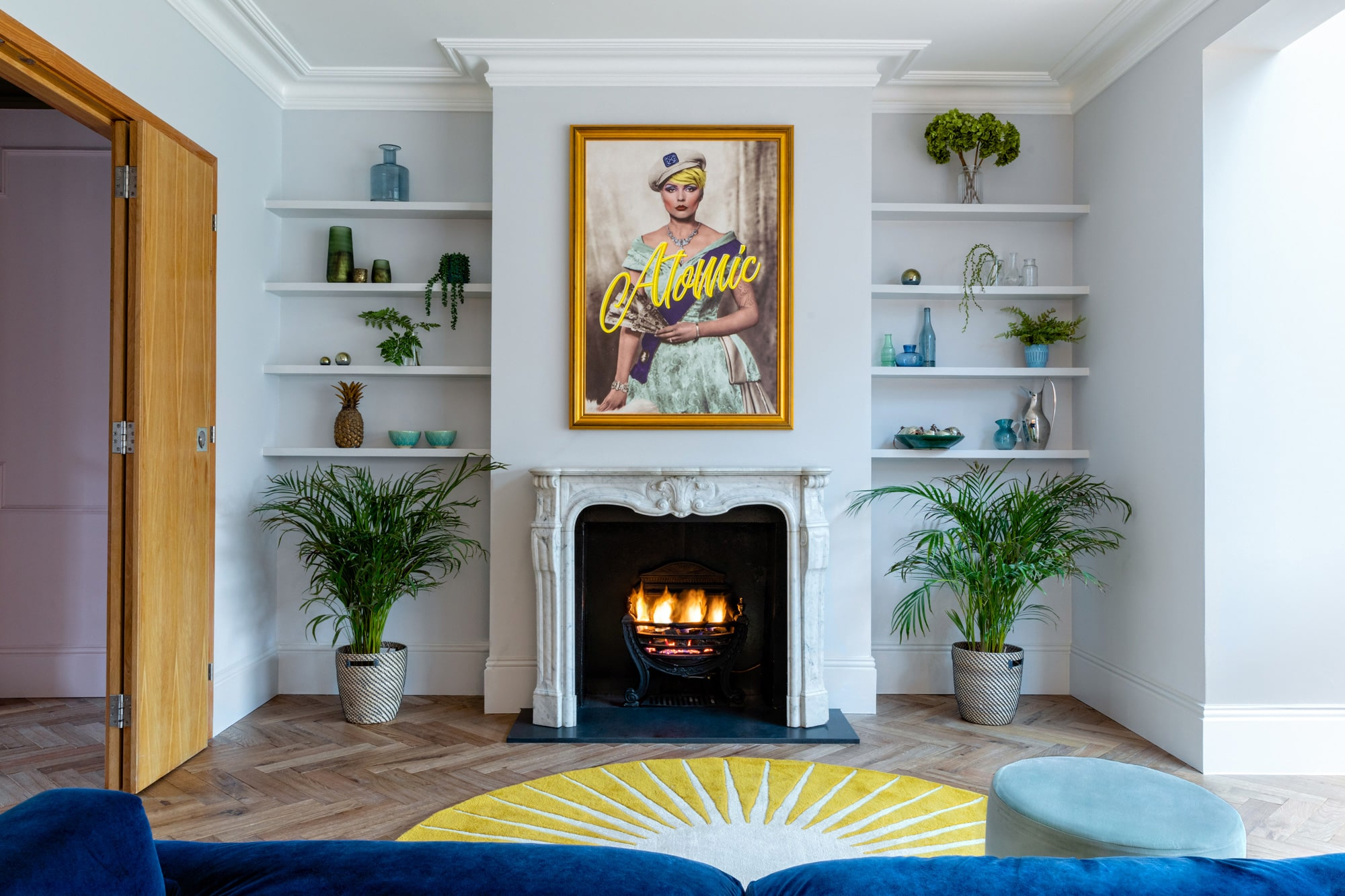 interior photo: sitting room with light blue walls; picture above a fire place with Debbie Harry with a sign