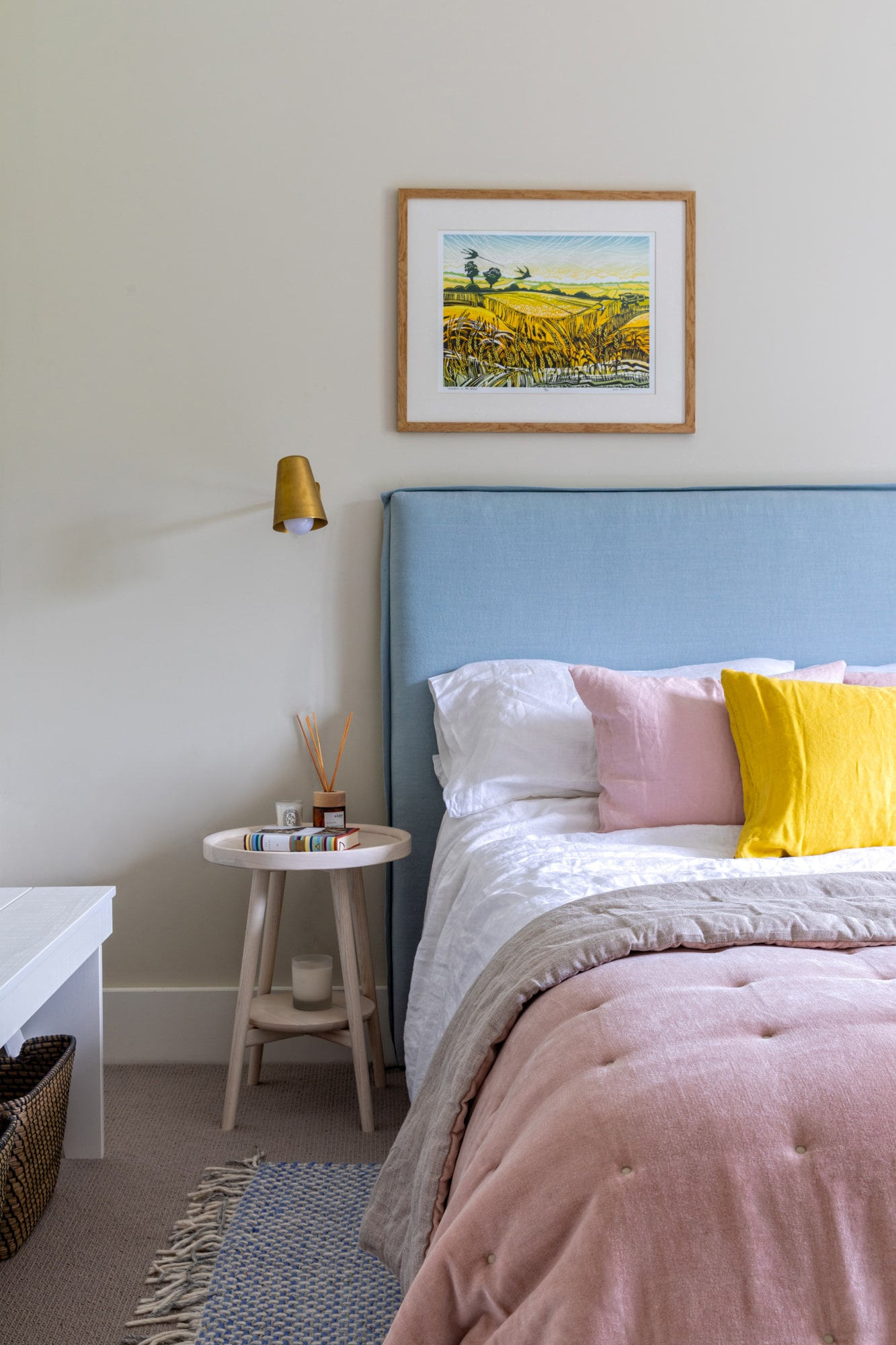 interior: bedroom in pink and blue colours with yellow details