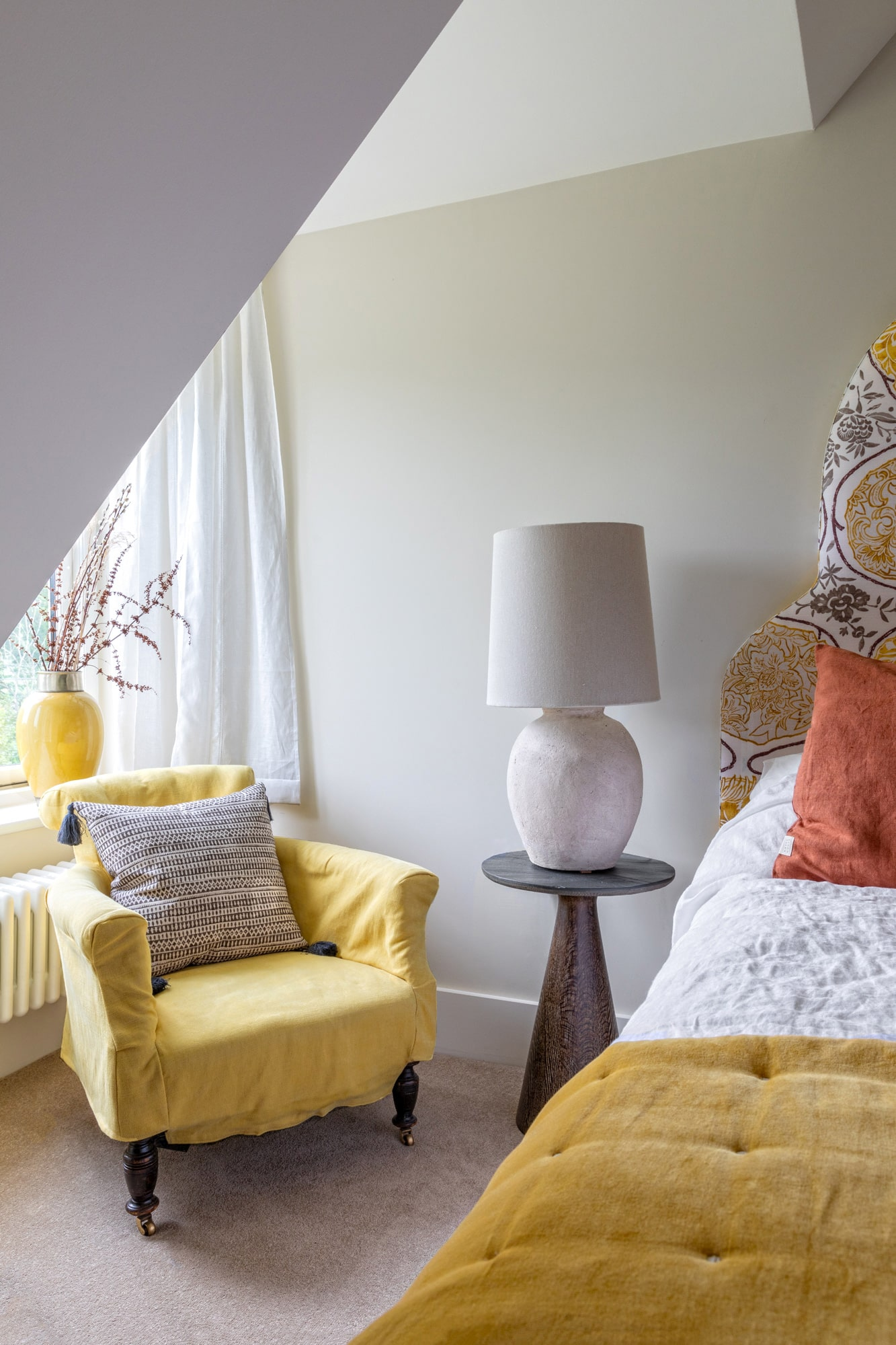 Interior photography: bedroom in yellow and terracotta colours