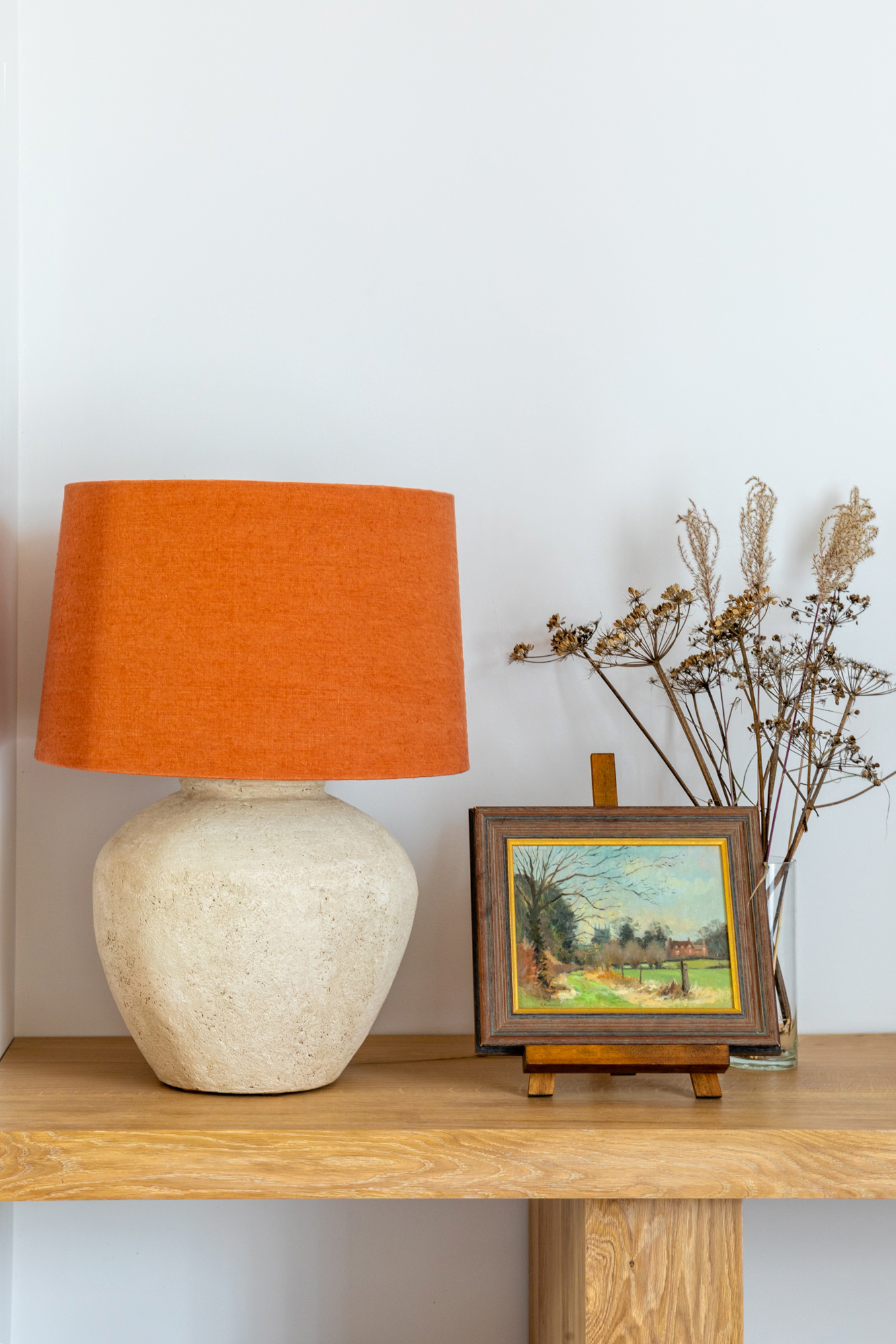 Interior design detail shot: plaster orange lamp and art