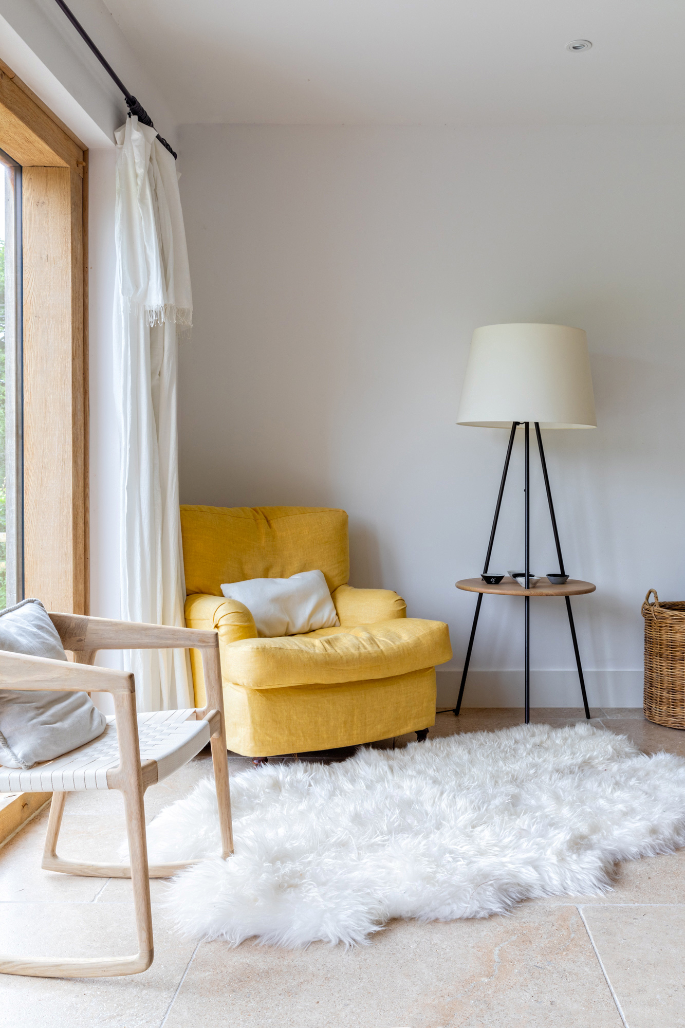Country house living room photo:  yellow armchair, lamp