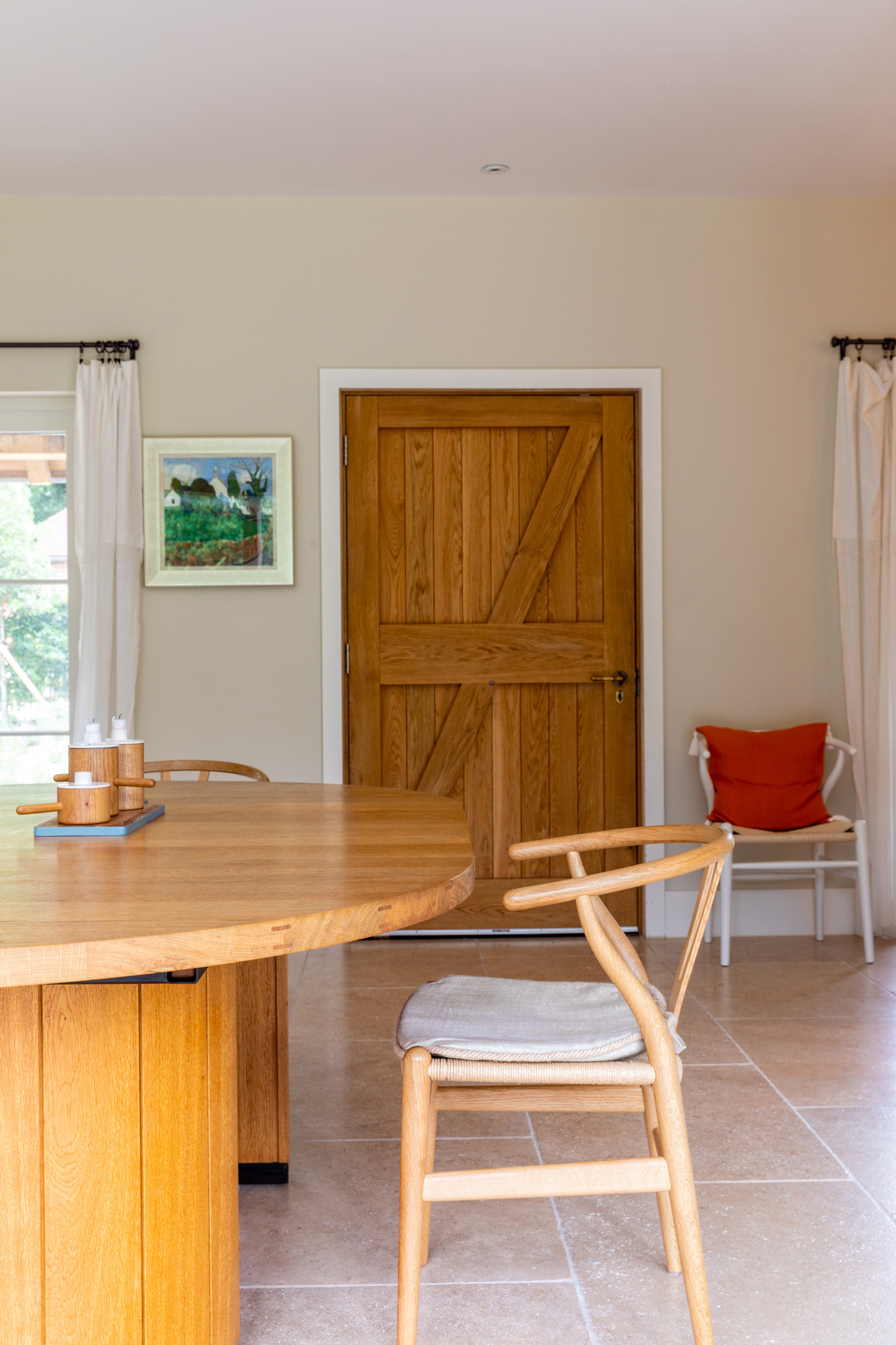 Country house living room photo: wooden table and chairs; wooden country door on the background