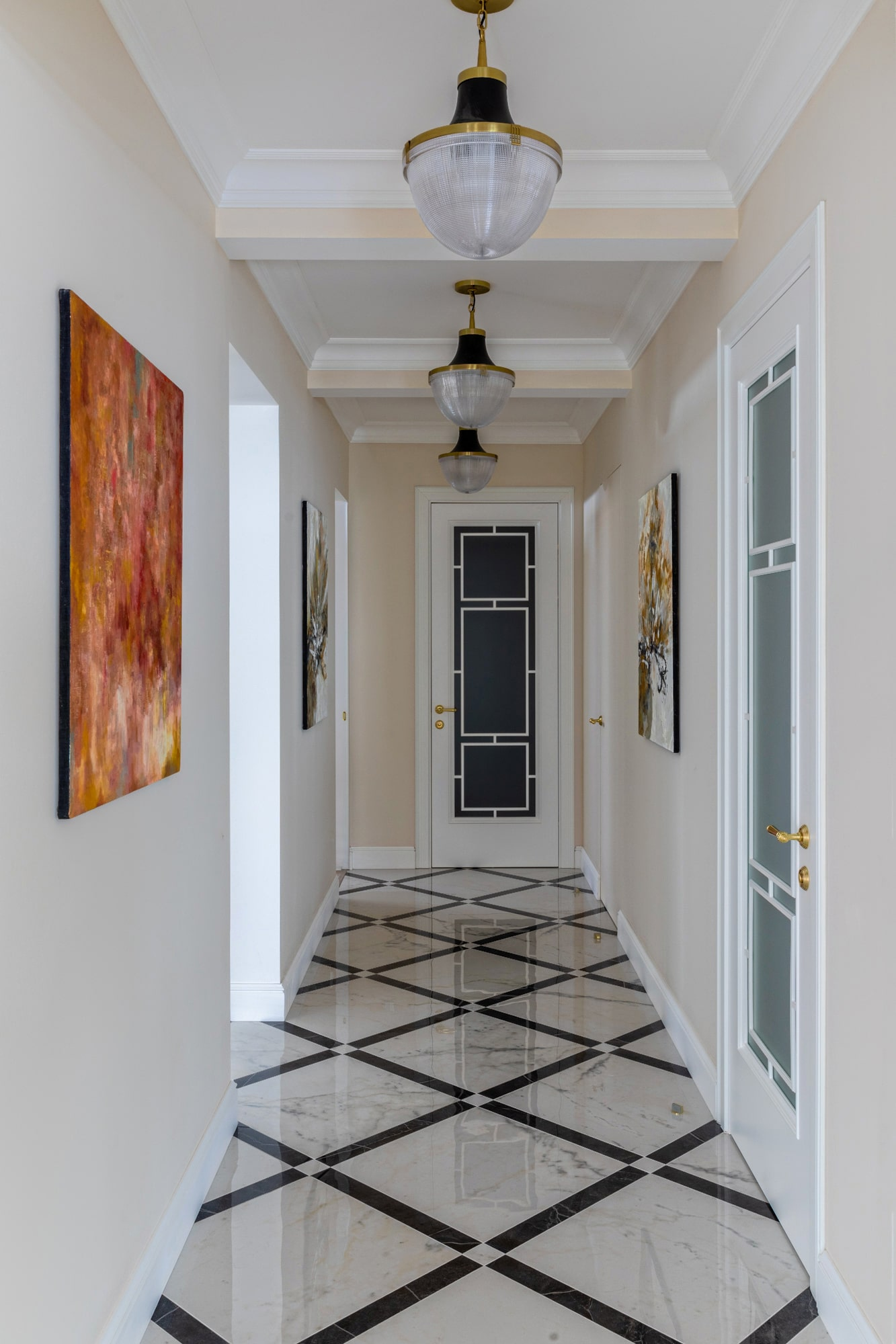 interior photo: hallway with marble tiles and a lot of art