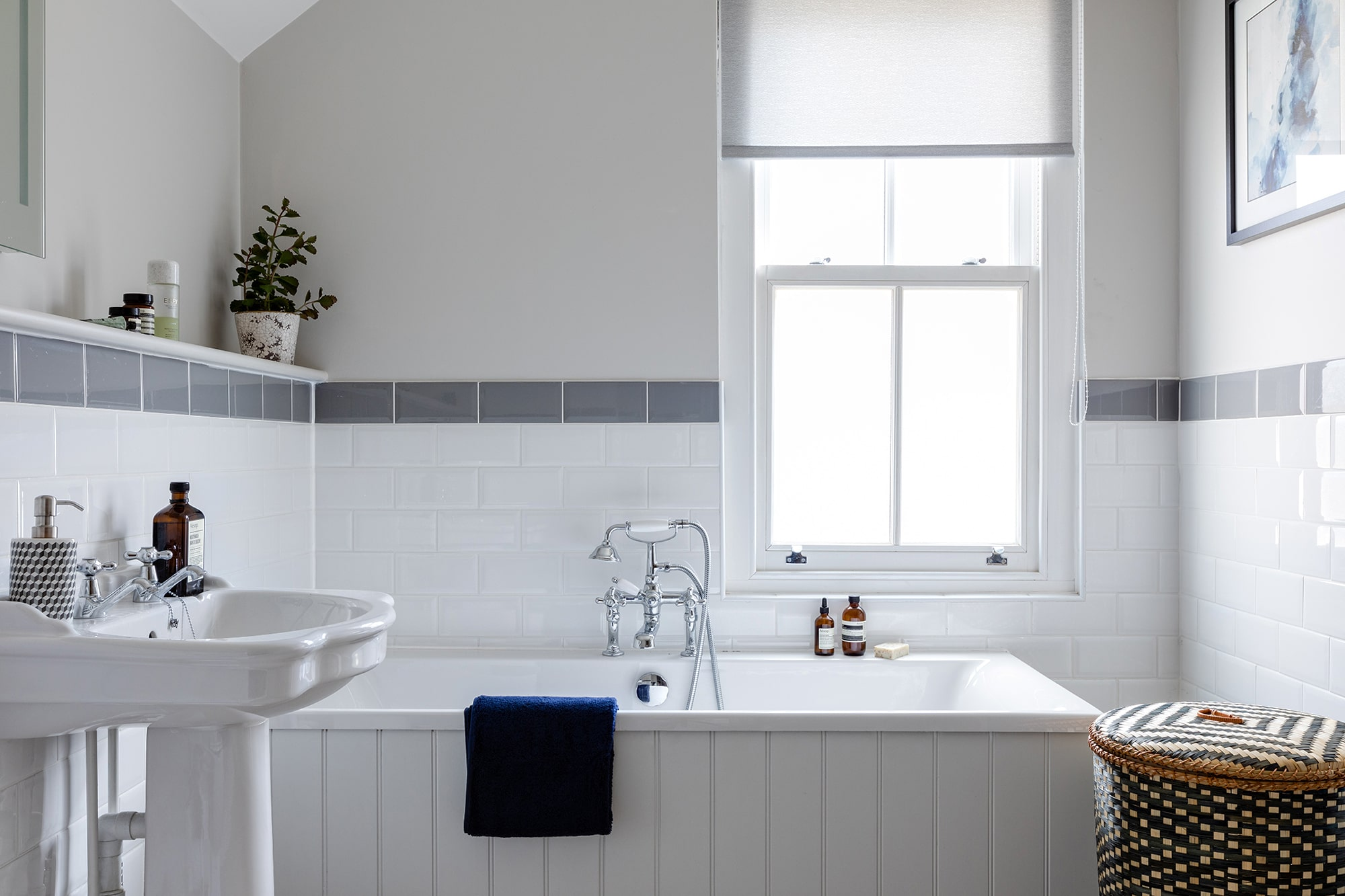 interior design photo of a bathroom with a window: bath tub and a sink