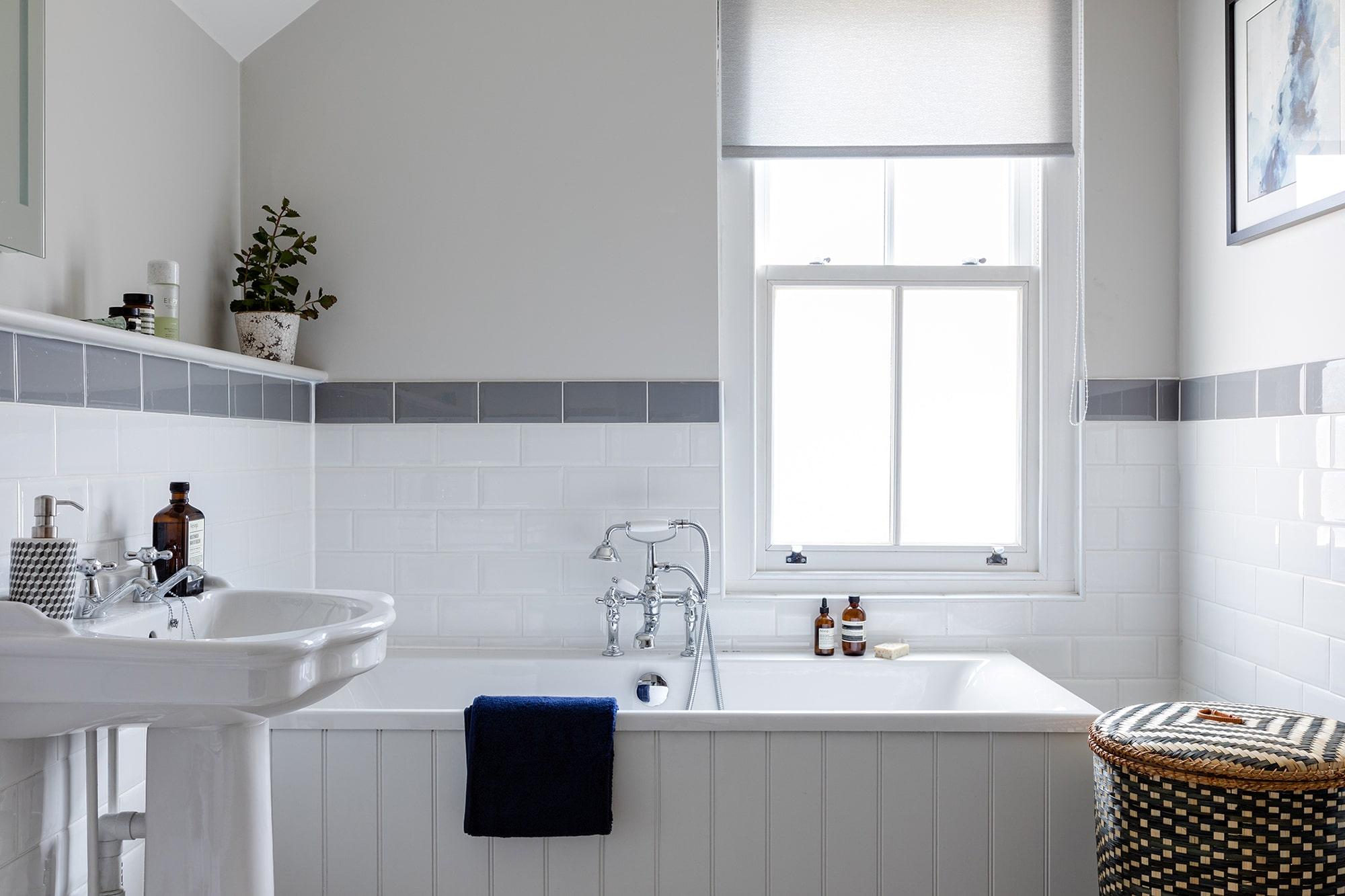 interior design photo of a bathroom with a window: bath tub and a sink