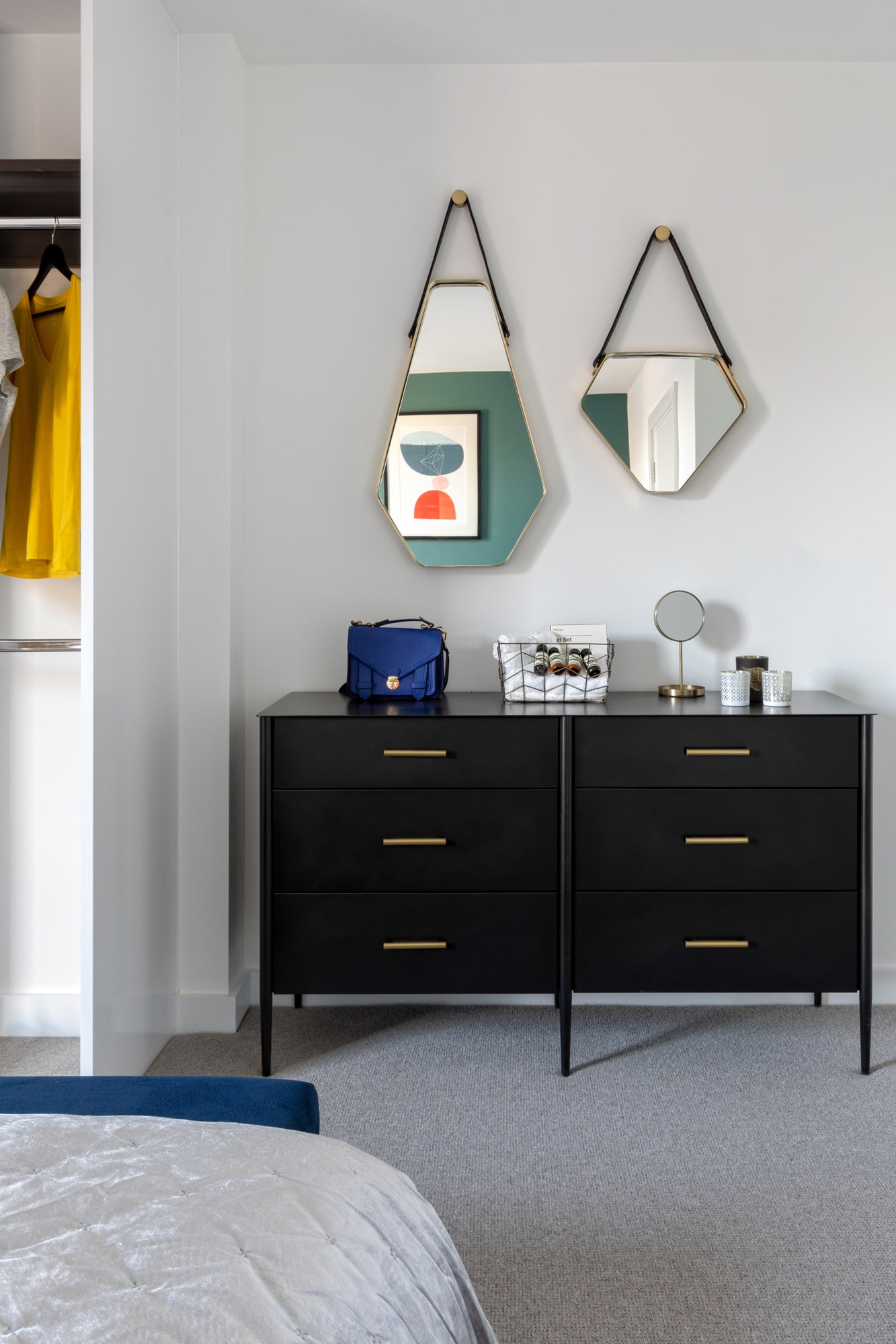 interior design photo: chest of drawers with triangle mirrors above
