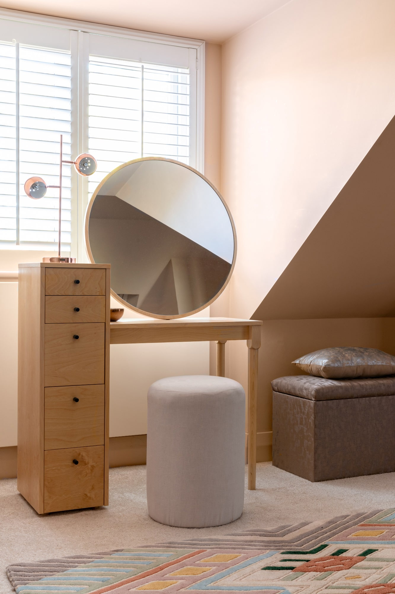 Nude bedroom: dressing table with round chair and round mirror