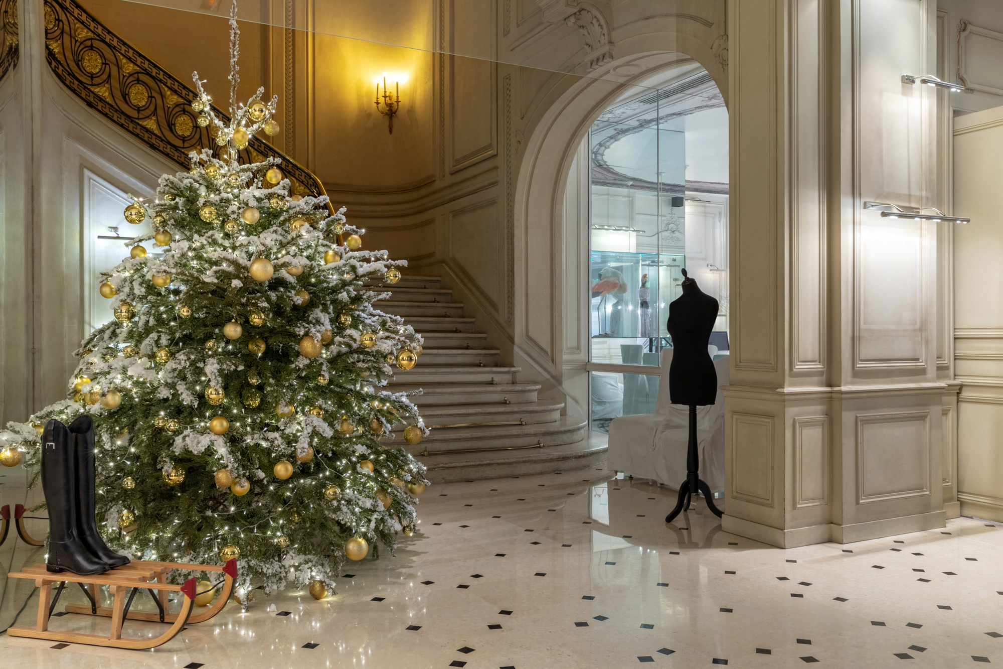 hotel reception; Christmas tree nest to a staircase