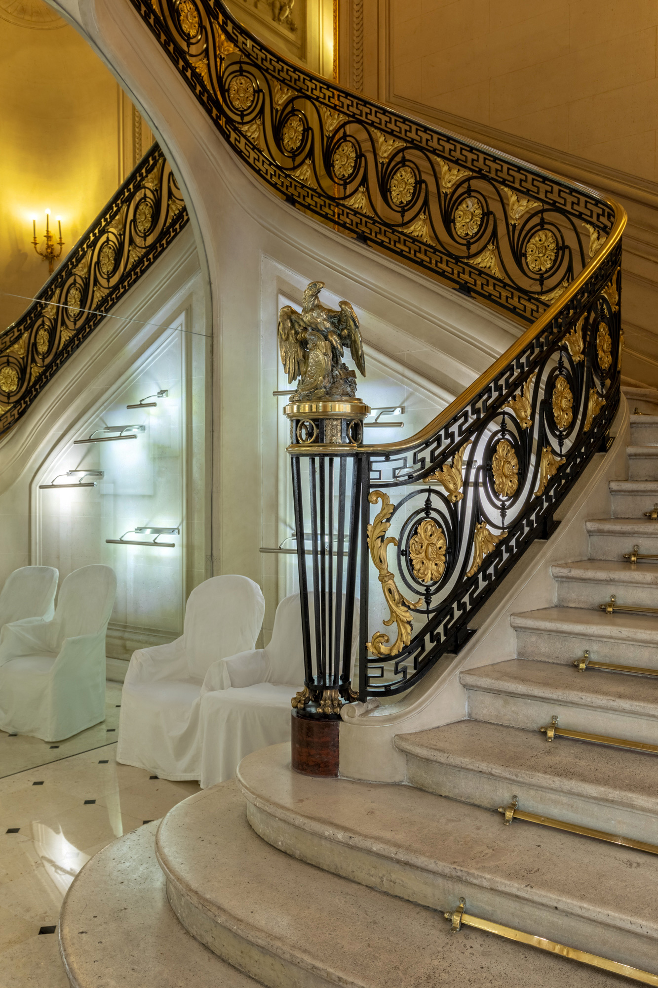 hotel staircase with a metal eagle