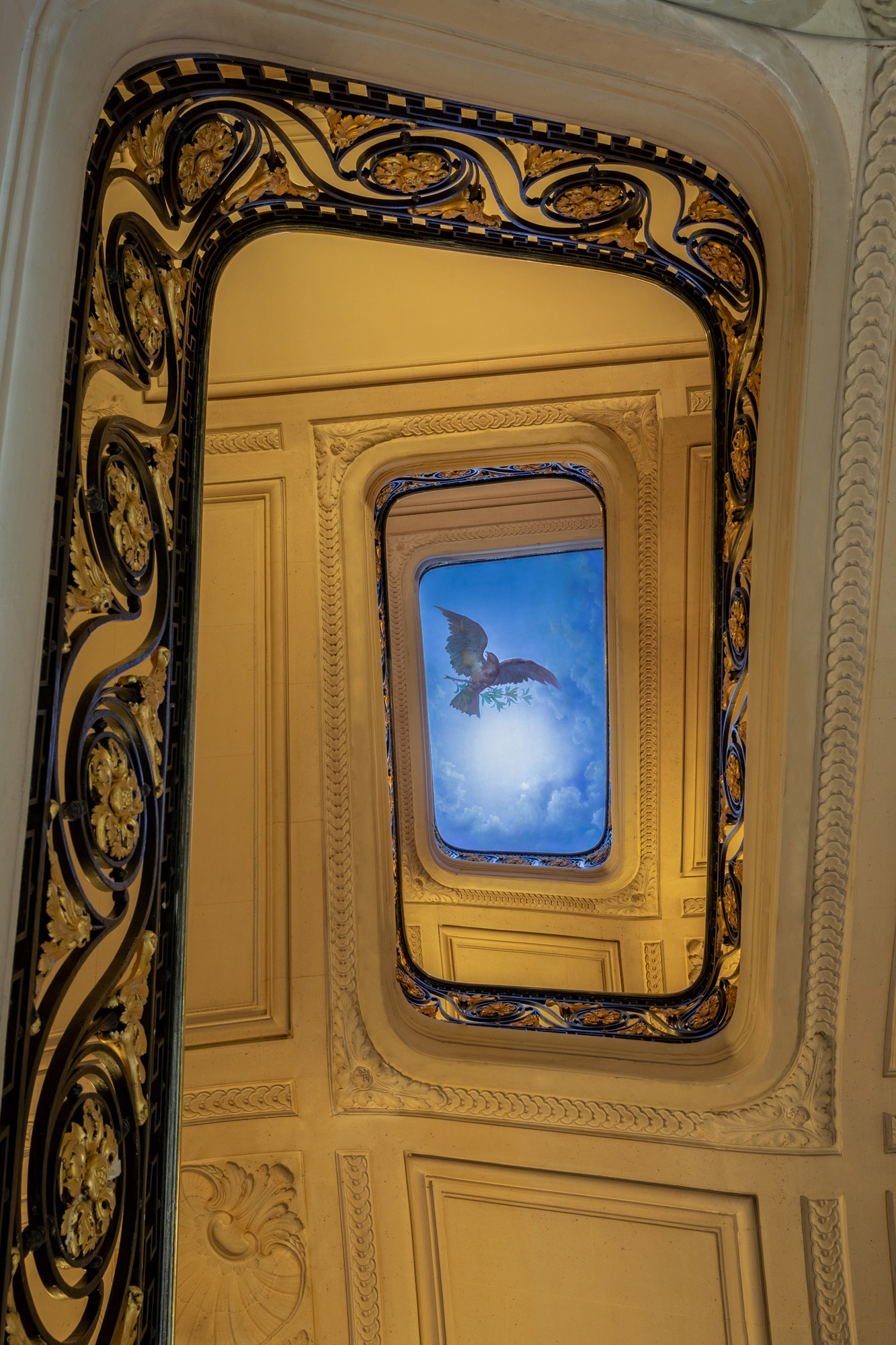 hotel staircase: view up the stairs on the eagle drawn on the ceiling