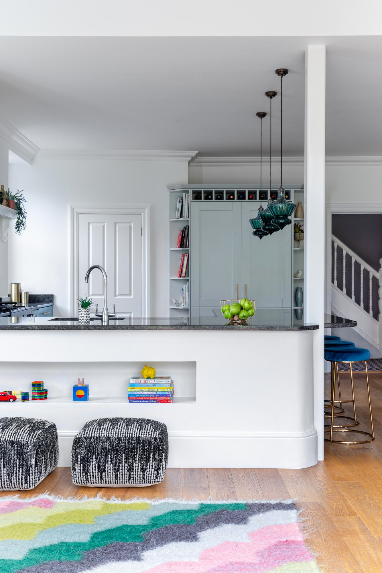 Interior photo from a living room to a kitchen
